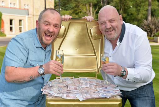NEVER BIN BETTER: County Down bin men Frank McCormick(44) from Newtownards and Stephen Inglis (46) from Bangor celebrate their wheelie good fortune after collecting a tasty £70,000 from a National Lottery Scratchcard.