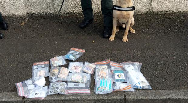 Police dog Max and some of the items discovered during the search