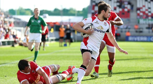 Home comfort: Ulster A's Conor Field runs in a try against Canada A during a pre-season friendly at the Kingspan Stadium