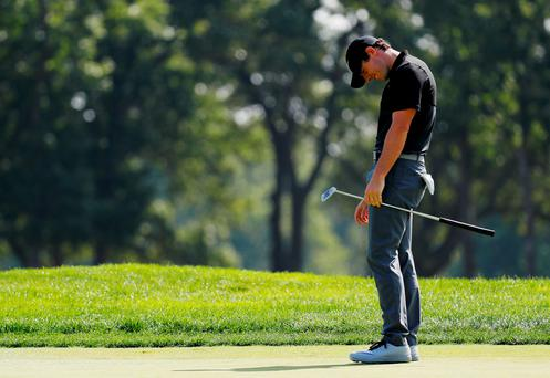 Off target: Rory McIlroy after missing a putt at the tenth during yesterday's second round at The Barclays