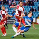 Sight at goal: Rangers' Joe Garner gets a shot away while challenged by Killie ace Luke Hendrie