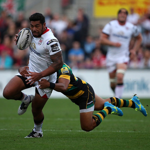 Running man: Charles Piutau strides forward