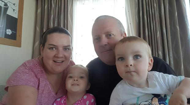 Kelly Waring, with her husband Neill and two children Olivia (4) and Ryan (18 months)