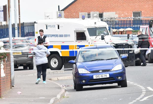 Police and Forensics at the scene after a stabbing in west Belfast. Photo Colm Lenaghan / Pacemaker Press