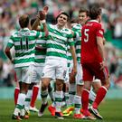Job done: Tom Rogic laps up the acclaim after his free-kick put the seal on Celtic's victory over Aberdeen on Saturday