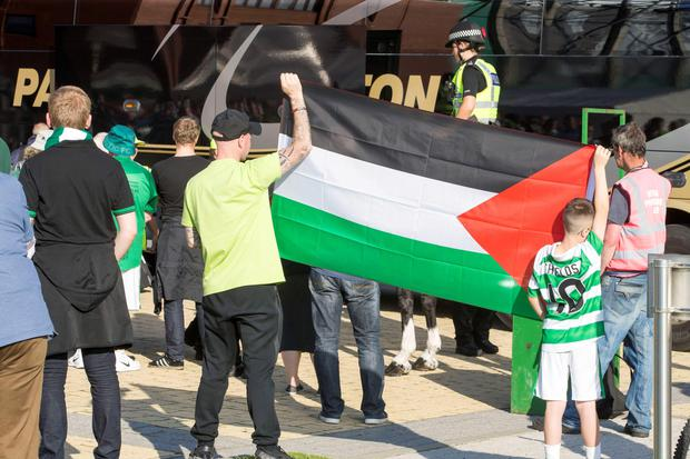 Celtic fans with Palestinian flag before Hapoel Be'er Sheva Champions League clash