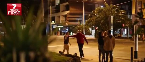 7 News footage appears to show Belfast man holding knife at the scene. Credit: 7 News