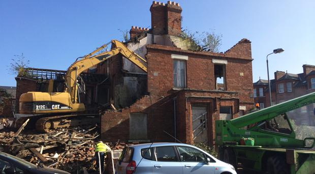 Damaged: The row of houses on Malone Avenue that has been partially demolished.