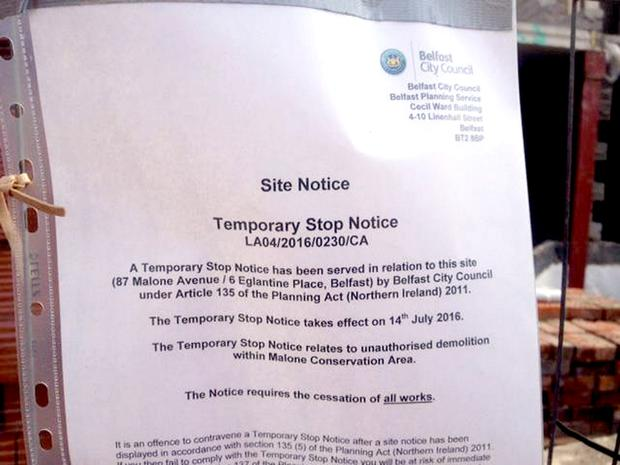 A temporary stop notice issued by Belfast City Council ordering developers to halt all work at the site on Malone Avenue.