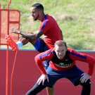 Limbering up: Wayne Rooney and Theo Walcott train ahead of England's 2018 World Cup qualifier against Slovakia