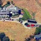 This image from aerial video provided by KABC-TV shows the home of entertainer Chris Brown with a police vehicle outside, in the Tarzana area of Los Angeles Tuesday, Aug. 30, 32016. (KABC-TV via AP)