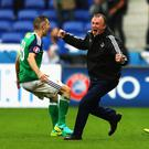 Special moment: Michael O'Neill celebrates as Northern Ireland defeat Ukraine at the Euro 2016 finals