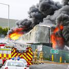 Firefighters at the scene of a major blaze at the WasteBeater Treatment Plant in west Belfast on August 31st 2016 ( Photo by Kevin Scott / Belfast Telegraph )