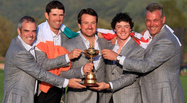 Prize guys: Paul McGinley, Padraig Harrington, Graeme McDowell, Rory McIlroy and Darren Clarke celebrate Ryder Cup success in 2010 but only the latter two will be involved for Team Europe against America at Hazeltine