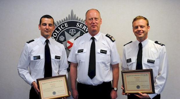 Chief Constable George Hamilton with Constable Richard Westbury (left) and Sergeant Scott Thompson Pic: PSNI