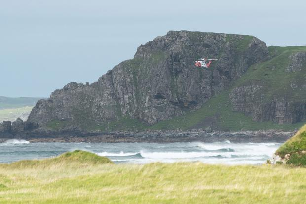 The Irish Coast Guard helicopter over Doagh Island, near where Anthony Griffiths' body was found