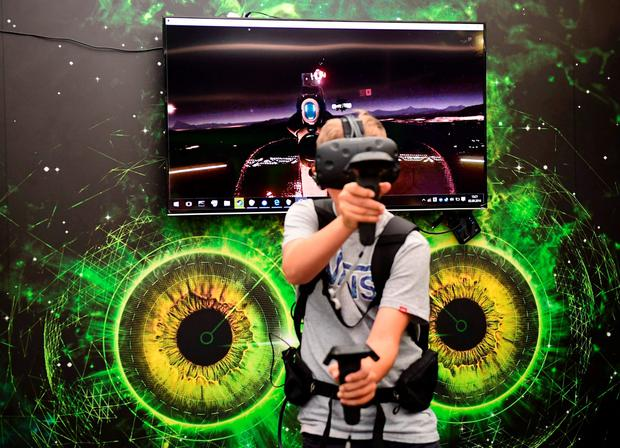 A boy plays a virtual reality game at the booth of XMG at the booth of Samsung promoting the Galaxy Note7 smartphone at the IFA (Internationale Funkausstellung) electronics trade fair in Berlin on September 2, 2016. AFP/Getty Images