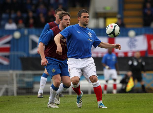 Bit of previous: Linfield manager and former Rangers ace David Healy came up against Jamie Mulgrew when the Gers visited Windsor Park in 2012