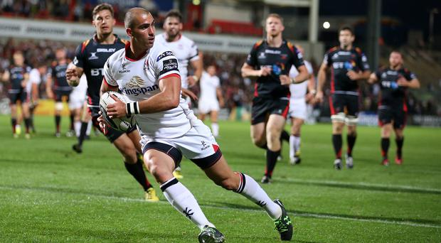 On the mark: Ruan Pienaar races through to score a try in Ulster's victory over Gwent Newport Dragons at Kingspan Stadium last night