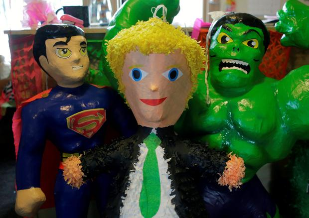 In this Tuesday, Aug. 30, 2016 photo, a Donald Trump pinata stands with other paper mache figures at a shop, in San Antonio. (AP Photo/Eric Gay)