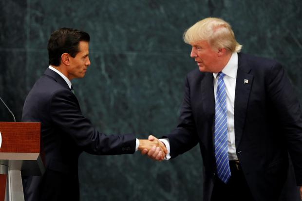 Mexico President Enrique Pena Nieto and Republican presidential nominee Donald Trump shake hands after a joint statement at Los Pinos, the presidential official residence, in Mexico City, Wednesday, Aug. 31, 2016. (AP Photo/Dario Lopez-Mills)