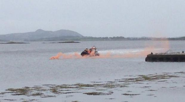 A search and rescue operation is under way after a car went into the water off a pier in County Donegal.
