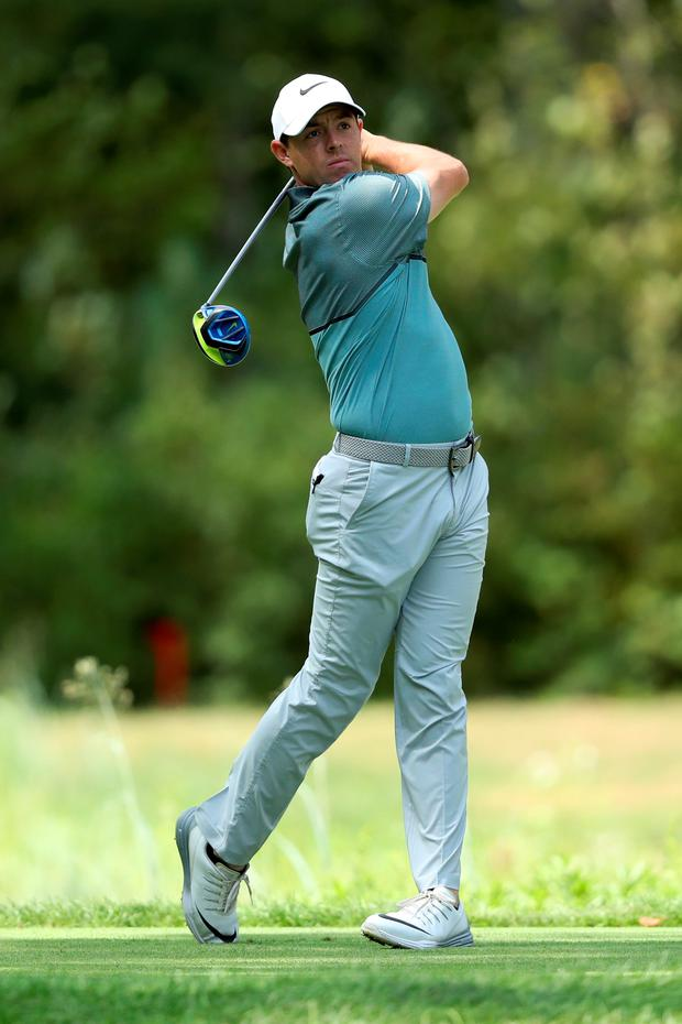 Eyes on prize: Rory McIlroy plays the fifth hole in last night's third round of the Deutsche Bank Championship at TPC Boston