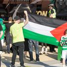 Celtic fans waving Palestine flags during a match in Israel