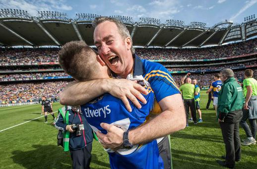 Champion: Michael Ryan beams with delight alongside Aidan McCormack