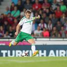 Effort: Northern Ireland captain Steven Davis gets a shot away despite Vladimir Darida's attempts to close him down