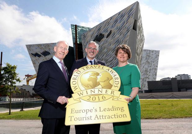 First Minister Arlene Foster joins celebrations with Titanic Belfast's Vice-Chairman Conal Harvey (left) and Chief Executive Tim Husbands MBE (centre), as it is named as Europe's Leading Visitor Attraction at the prestigious World Travel Awards. Photographer William Cherry / Press Eye