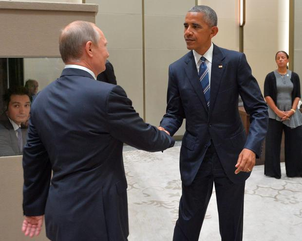 Russian President Vladimir Putin (L) shakes hands with his US countepart Barack Obama during a meeting on the sidelines of the G20 Leaders Summit in Hangzhou on September 5, 2016. AFP/Getty Images