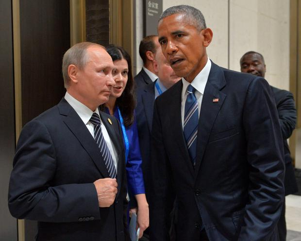 Russian President Vladimir Putin (L) meets with his US countepart Barack Obama on the sidelines of the G20 Leaders Summit in Hangzhou on September 5, 2016. AFP/Getty Images