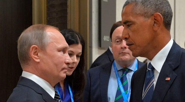 Russian President Vladimir Putin (L) meets with his US counterpart Barack Obama on the sidelines of the G20 Leaders Summit in Hangzhou on September 5, 2016. AFP/Getty Images