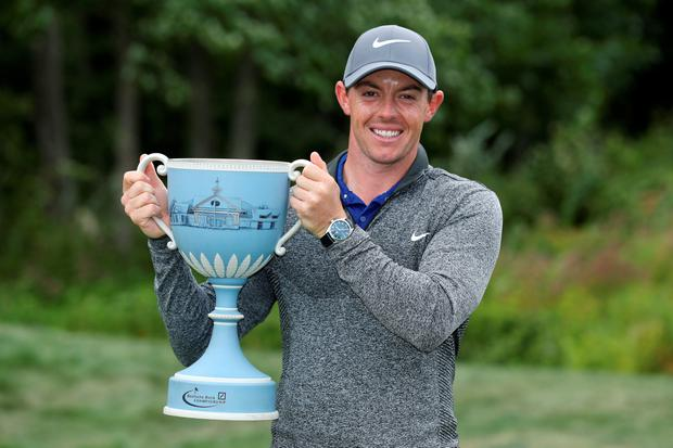 Rory McIlroy with Deutsche Bank trophy
