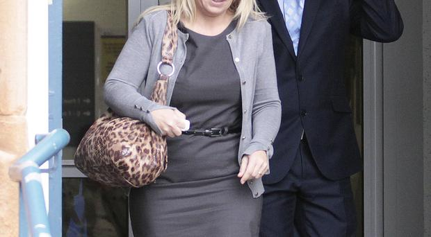 Paul Frew MLA and his wife Julie leave court yesterday