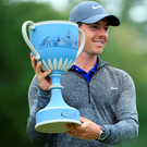 Prize guy: Rory McIlroy lifts the Deutsche Bank title after his majestic comeback