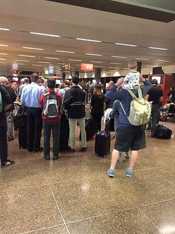 People queuing at Seattle Tacoma International Airport in the USA after an IT glitch hit British Airways check-in systems. Pic: Matthew Walker/PA Wire