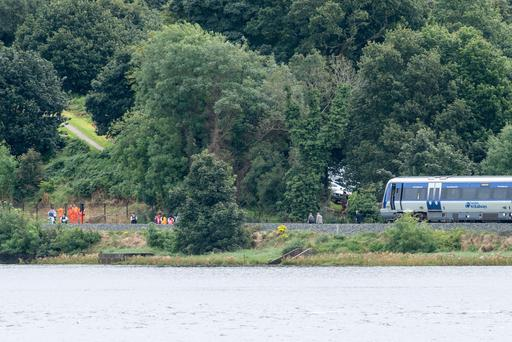 The scene on the railway line in Londonderry where investigations continued on Tuesday following the death of a person on the line. The line was closed and a bus substitution service put into operation. Picture Martin McKeown. Inpresspics.com. 6.09.16