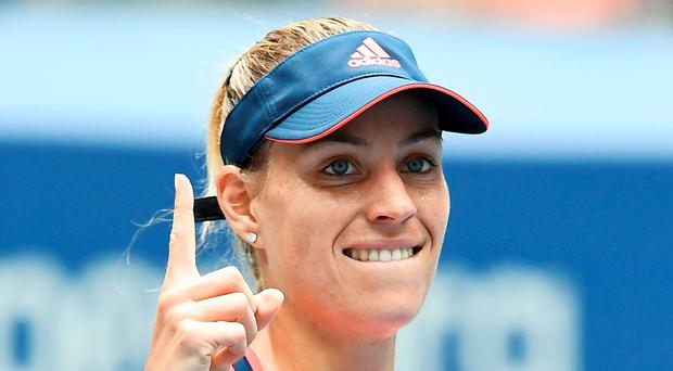 Moving on up: Angelique Kerber on the way to victory last night