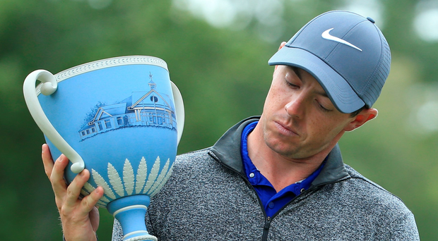 Victorious: Rory McIlroy holds the Deutsche Bank Championship trophy