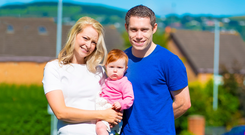 Winning combination: Jason Smyth with his wife Elise and young daughter Evie at their home in Dunmurry