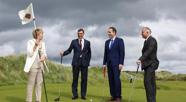 Communities Minister, Paul Givan is pictured with (L-R) with the Mayor of Causeway Coast and Glens Alderman Maura Hickey and 2019 Open Championship Committee members Philip Tweedie and John Bamber. Photo Lorcan Doherty Photography