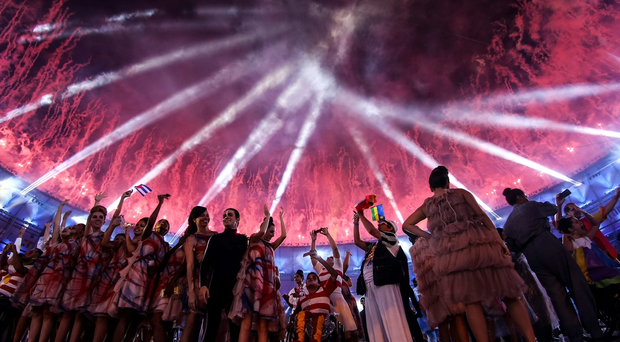Atheletes and performers enjoy fireworks during the Opening Ceremony of the Rio 2016 Paralympic Games at Maracana Stadium on September 7, 2016 in Rio de Janeiro, Brazil. (Photo by Buda Mendes/Getty Images)