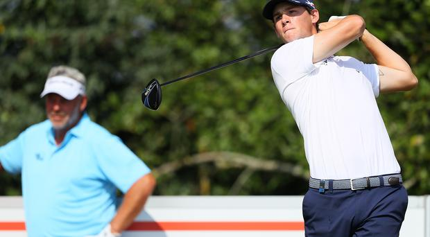Minor worry: Thomas Pieters, pictured with an onlooking Darren Clarke, had a serious allergic reaction to a bee sting