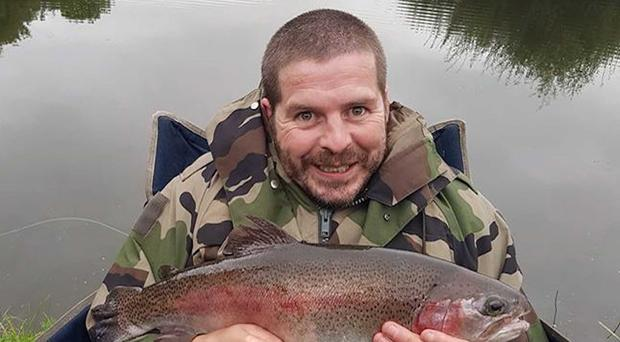 Great catch: Finbar McNamee shows off his nice Glenkeen Fishery rainbow trout, one of his personal best haul of eight fish