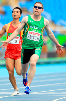 Striding ahead: Jason Smyth takes gold in the T13 100m in Rio, his fifth triumph at the Paralympics