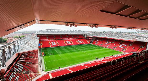 Stand and deliver: Liverpool's revamped Anfield after the £115million rebuild
