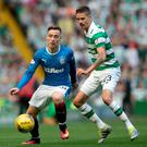 Ranger's Barrie McKay (left) and Celtic's Mikael Lustig battle for the ball during the Ladbrokes Scottish Premiership match at Celtic Park, Glasgow. Pic Andrew Milligan/PA Wire