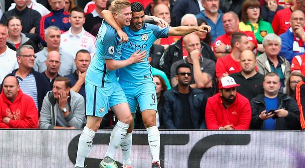 MANCHESTER, ENGLAND - SEPTEMBER 10: Kevin De Bruyne of Manchester City celebrates scoring his sides first goal with his team mate Nolito of Manchester City during the Premier League match between Manchester United and Manchester City at Old Trafford on September 10, 2016 in Manchester, England. (Photo by Clive Brunskill/Getty Images)